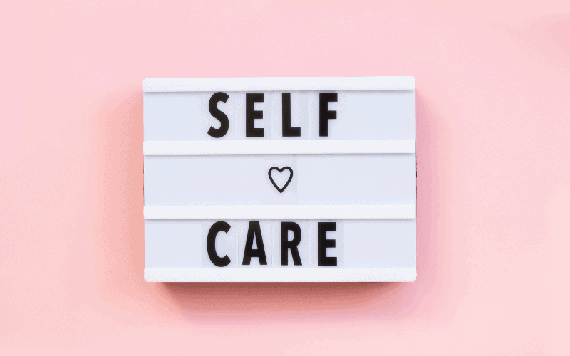 A sign that has self care on it