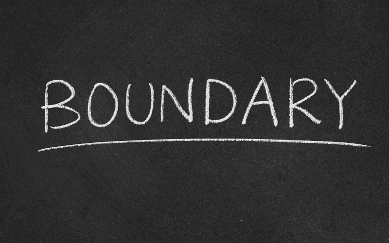 Boundary wrote in chalk on chalk board