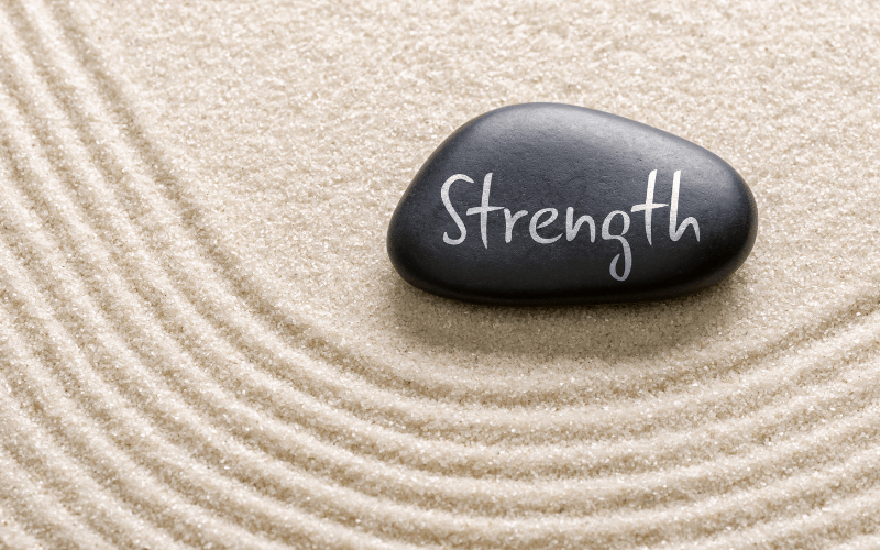 strength wrote on a rock